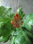 http://www.tweedvixen.co.uk/iridescent-lacey-oak-leaf-pendant-and-chain-217-p.asp