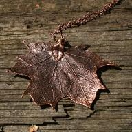 http://www.tweedvixen.co.uk/vintage-copper-maple-leaf-pendant-and-chain-190-p.asp
