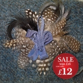 http://www.tweedvixen.co.uk/feather-brooch-with-blue-ribbon-612-p.asp