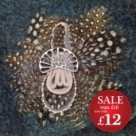 http://www.tweedvixen.co.uk/feather-brooch-with-pink-ribbon-603-p.asp