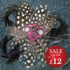 http://www.tweedvixen.co.uk/feather-brooch-with-red-ribbon-600-p.asp