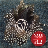 http://www.tweedvixen.co.uk/feather-brooch-with-white-swirl-606-p.asp